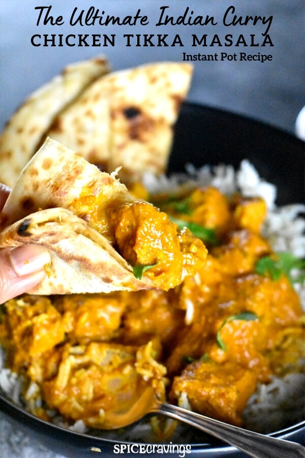 Scooping chicken curry with naan bread