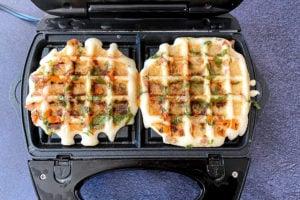 golden brown vegetable waffles in waffle maker