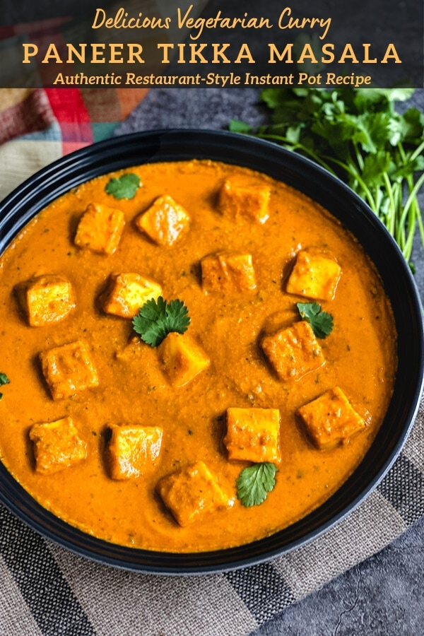 Paneer in tomato sauce garnished with cilantro