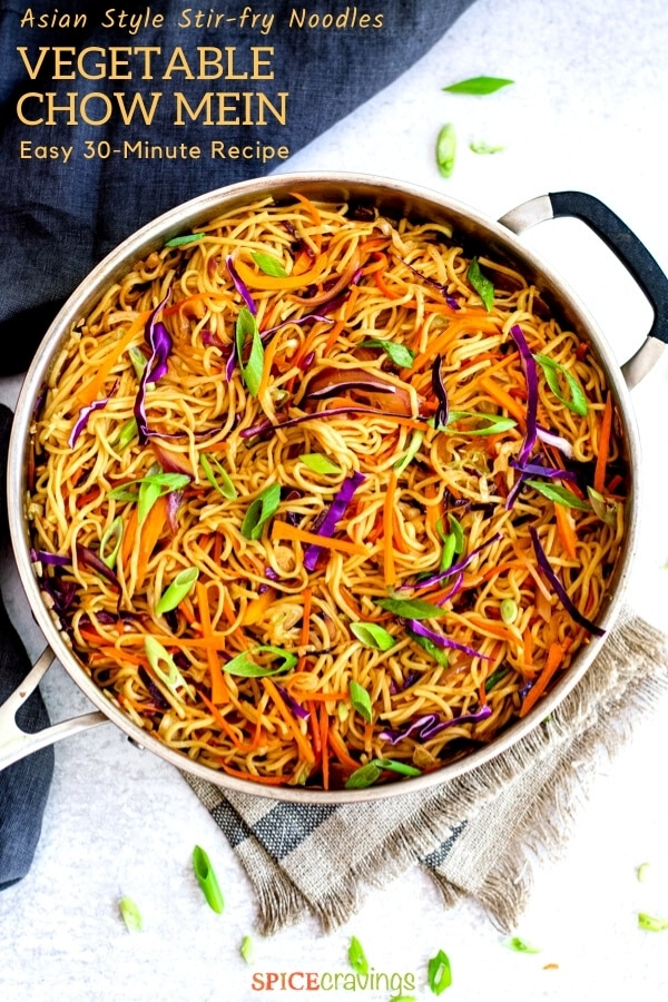 sitr fried chinese noodles with vegetables in stainless steel chef pan