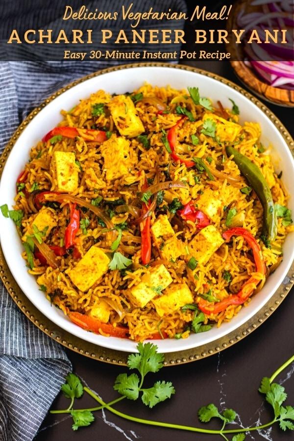achaari paneer biryani recipe in white bowl with cilantro sprigs