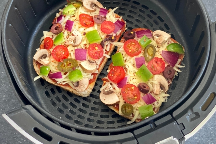 slices of bread, cheese and vegetable toppings in air fryer