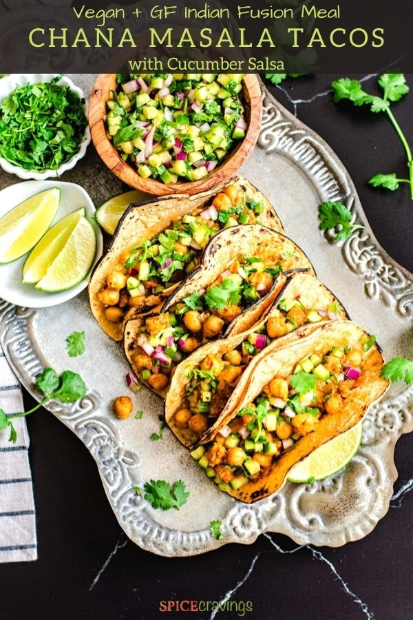 chana masala tacos with cucumber salsa on silver serving platter with lime wedges and cucumber salsa on side