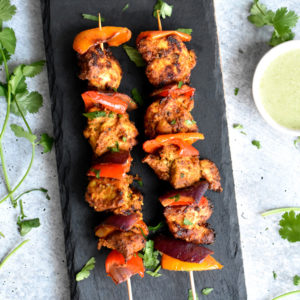 Chicken tikka and pepper skewered on bamboo sticks
