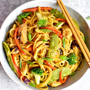 Chicken Lo Mein noodles in a grey bowl with chopsticks