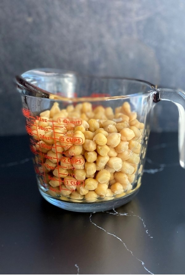 cooked chickpeas in measuring cup