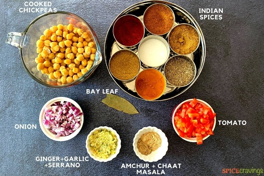 cooked chickpeas, chopped onion, ginger, garlic, tomatoes and tray of Indian spices