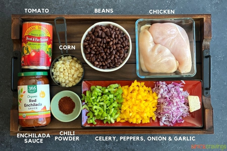 chicken breasts, black beans, enchilada sauce, fire roasted tomatoes, chopped onions, celery, peppers, garlic, chili powder