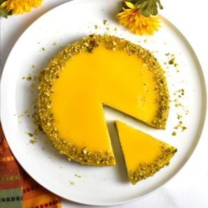 Mango flavored cheesecake on a white plate