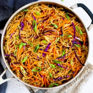Vegetable chow mein with cabbage and carrots in a chef's pan