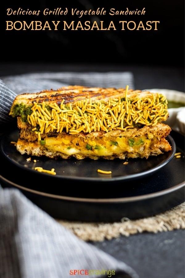 mumbai sandwich toast coated in sev on black plate