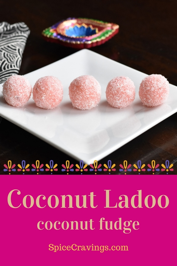 five blush pink coconut fudge balls on white plate with black background
