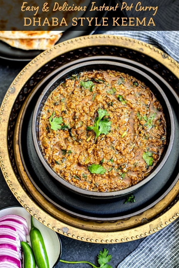 keema curry in black bowl garnished with cilantro sprigs
