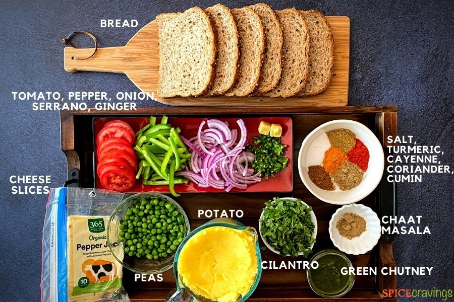 whole grain bread slices, sliced tomato, pepper, onion, Indian spices, mashed potatoes, peas, green chile