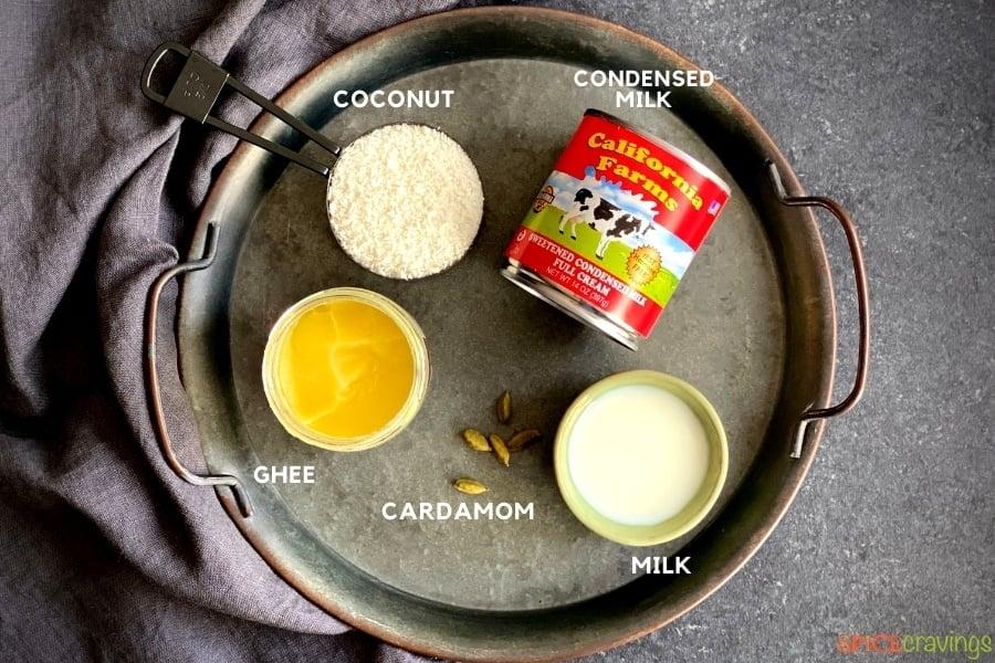 desiccated coconut, sweetened condensed milk can, ghee, cardamom, milk