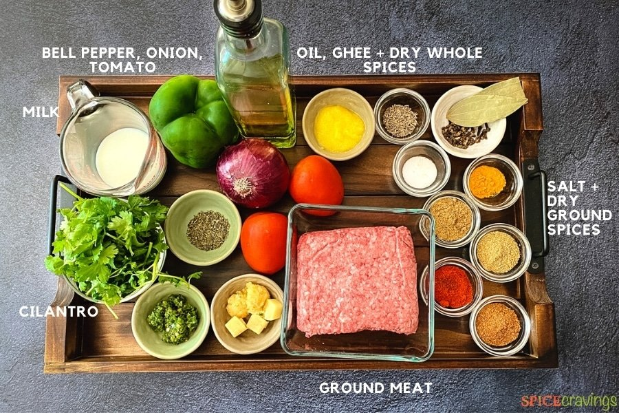 milk, pepper, olive oil, onion, tomatoes, cilantro, garlic and ginger cubes, ground meat, whole and ground Indian spices