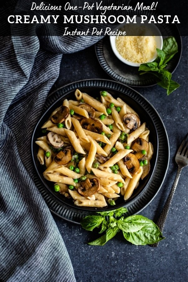 mushroom pasta recipe in black bowl with grated cheese and fresh basil