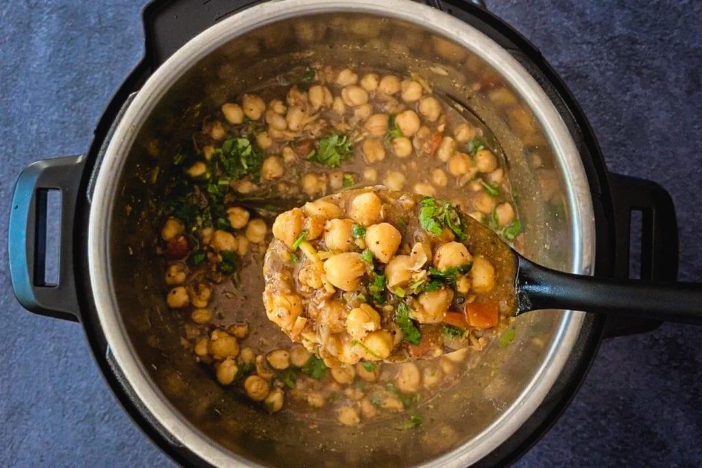 spoonful of punjabi chole recipe over instant pot