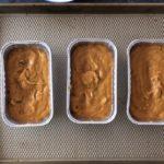 pumpkin bread batter in three mini loaf pans