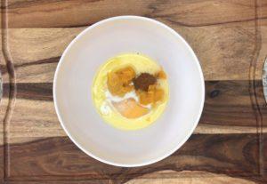 pumpkin, egg, milk and pumpkin pie spice in white bowl