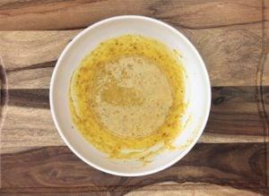 melted butter over mixture of pumpkin, egg and milk