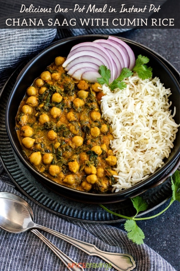 chana saag and cumin rice with sliced red onions in black bowl