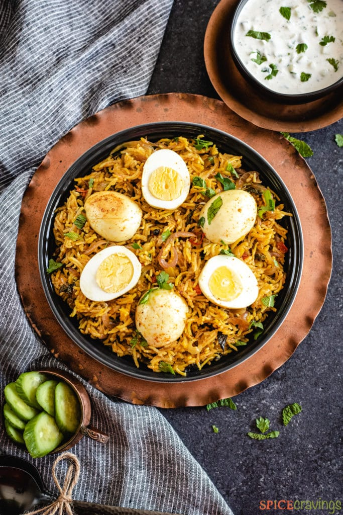 spicy eggs and rice in black bowl