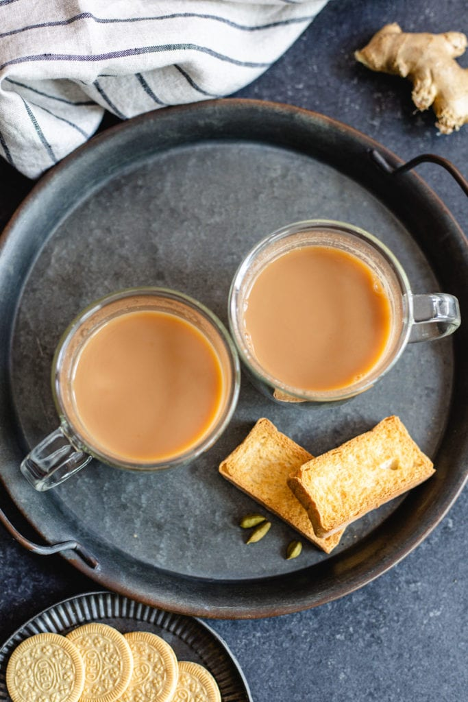 Top shot of two cups of Indian tea with milk