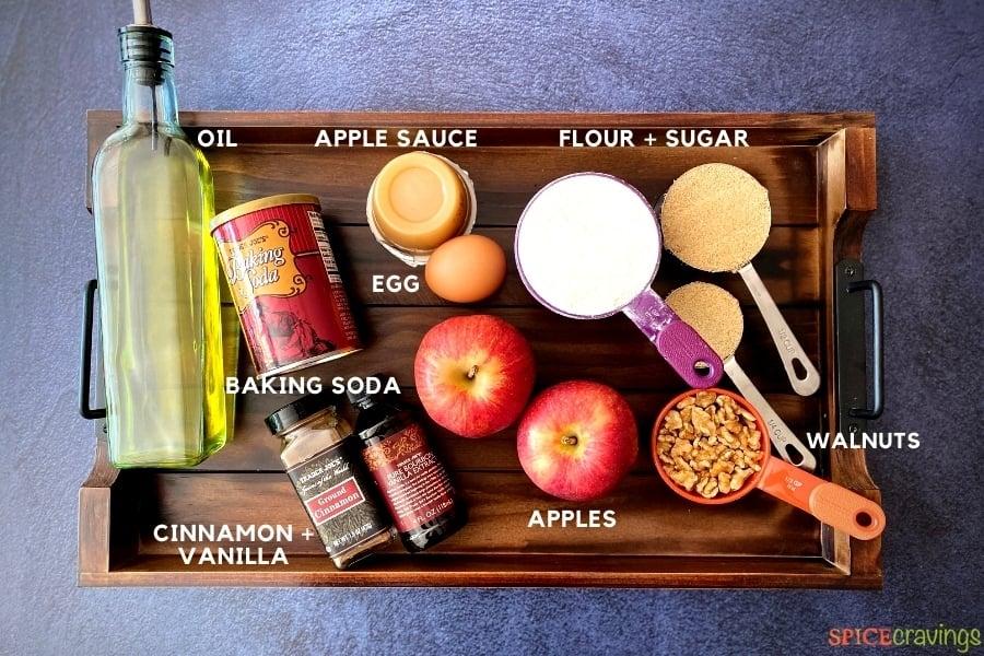 oil, baking soda, applesauce, cinnamon, vanilla, apples, egg, flour, palm sugar, walnuts