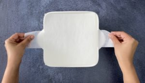 Lining a baking pan with parchment liners