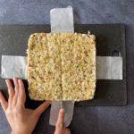 Cutting ricotta kalakand into squares