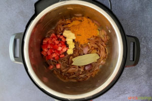 chopped tomatoes, ground spices, bay leaf, garlic, ginger, fried onions in instant pot