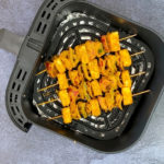 four prepared paneer tikka skewers in air fryer