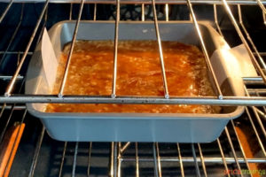 cinnamon-sugar topped apple cake in baking pan in oven