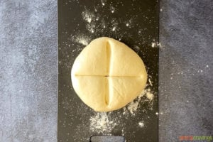 ball of dough scored into four sections