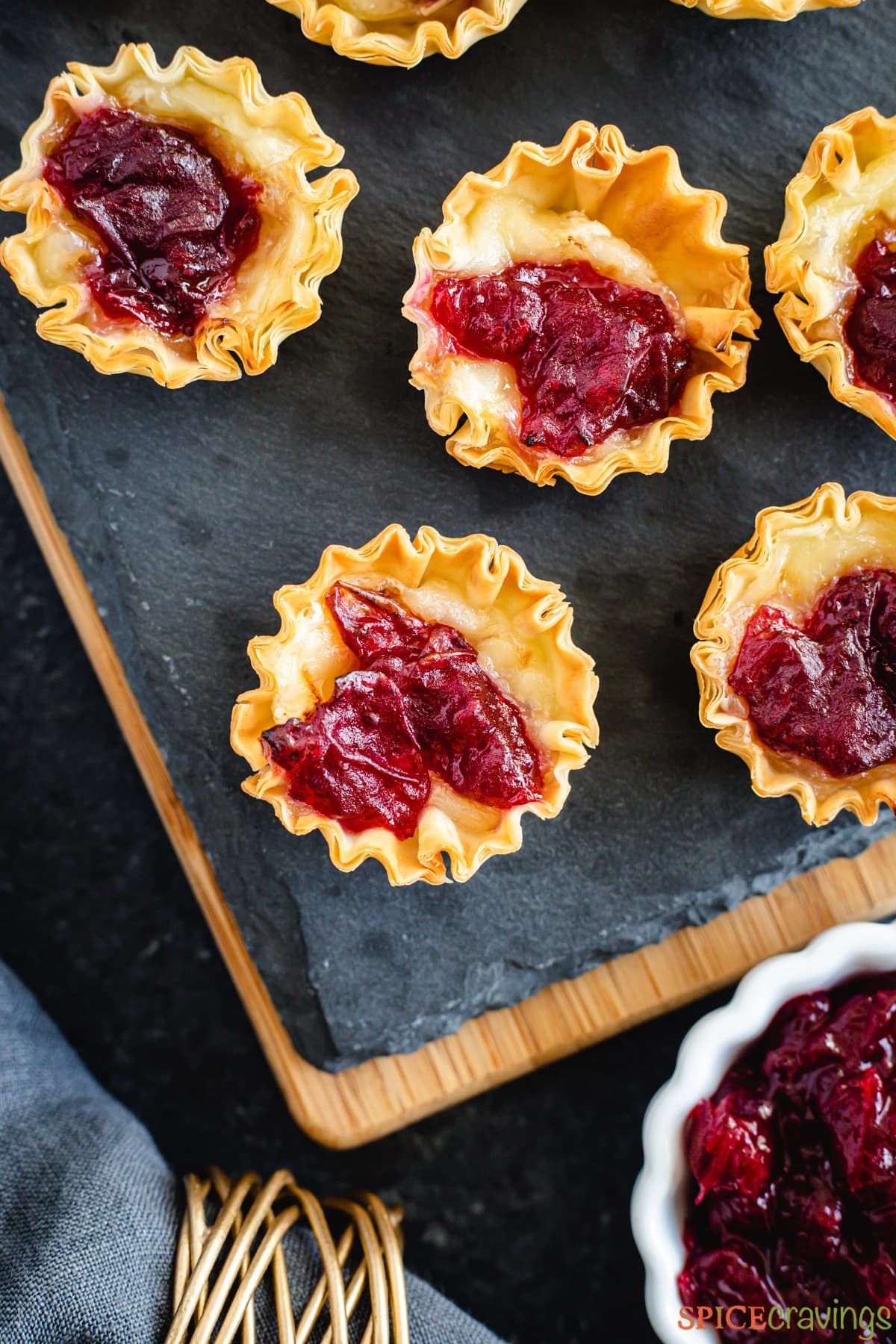 Close-up of brie bites topped with cranberry sauce