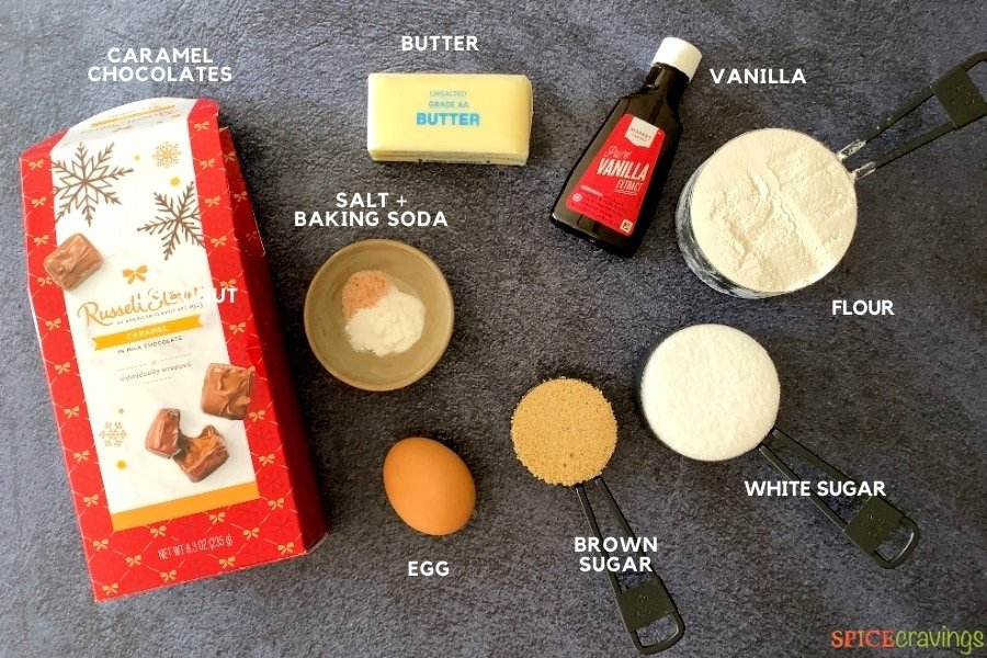 Ingredients to make caramel chocolate cookies on a grey mat