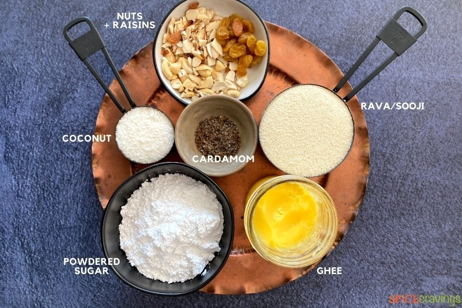 Ingredients for rava ladoo on copper plate