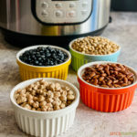 4 bowls of dried beans next to an Instant Pot