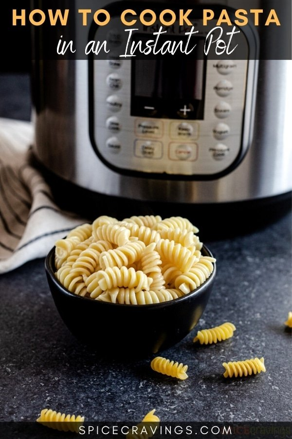 Cooked rotini in a bowl next to instant pot