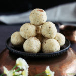 Suji ladoo stacked on a metal plate