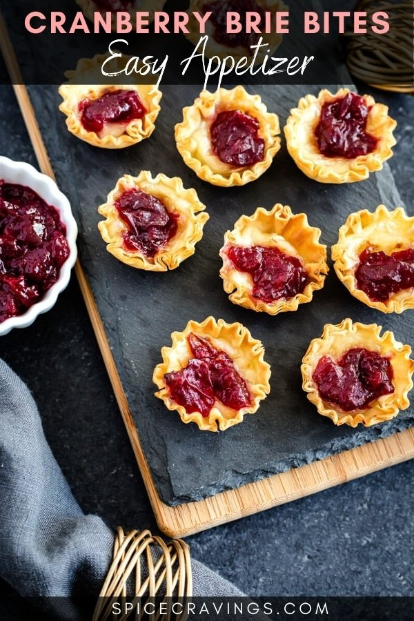 Brie bites with cranberry on a tray