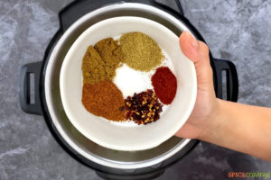 Pouring the spices into the Instant Pot