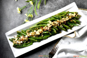 Sauteed green beans topped with almond chips