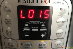 A timer showing 15 minutes past cooking time on an Instant pot