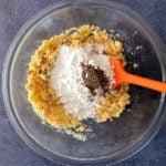 Powder sugar and cardamom in bowl with semolina mix