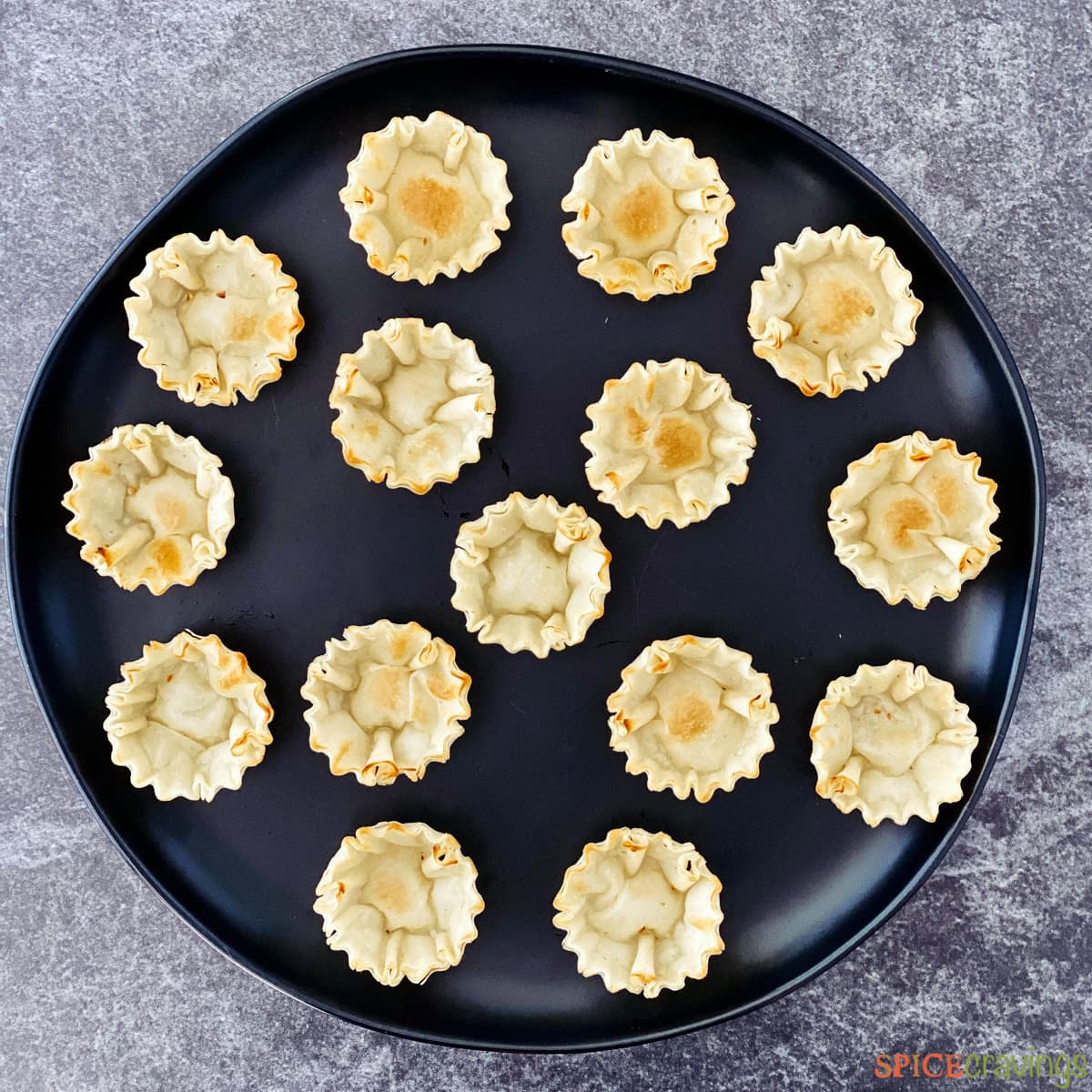 Empty phyllo cups on a round tray