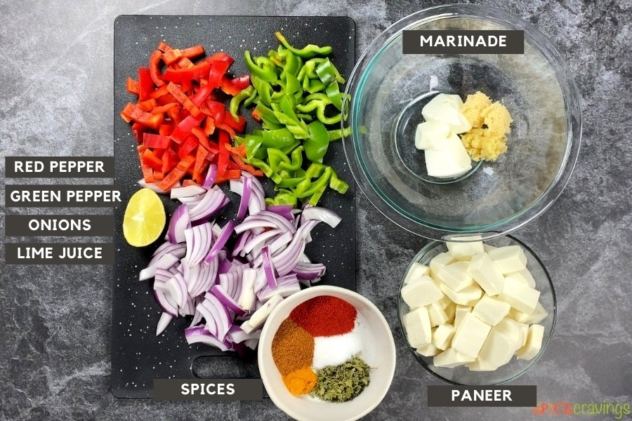 All the ingredients for kathi rolls with paneer on a counter