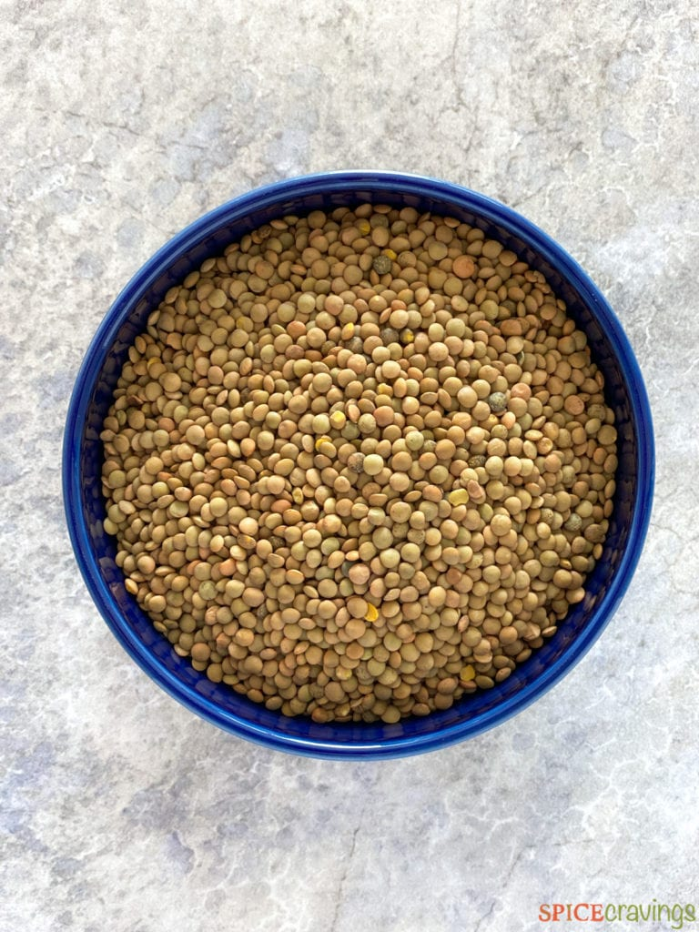 Bowl of uncooked dry green lentils