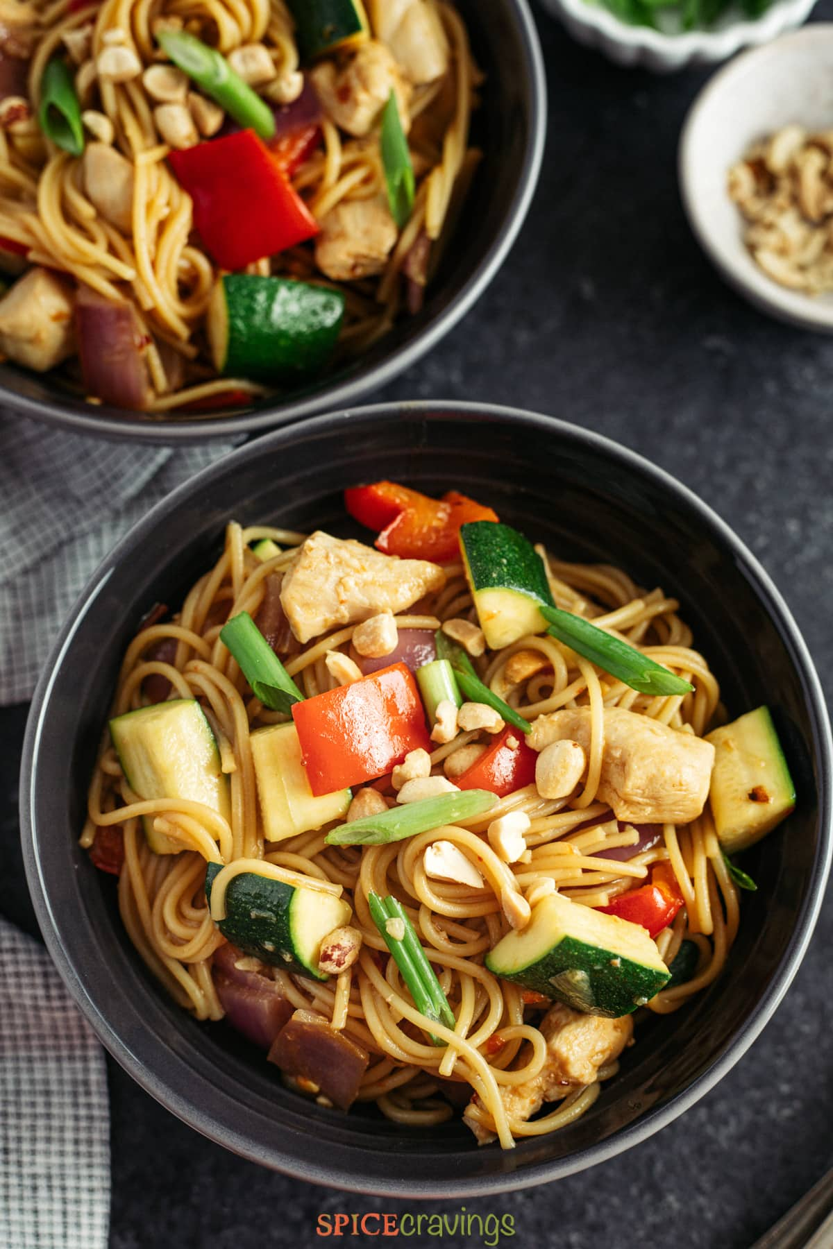 Overhead shot of two bowls of Chinese pasta